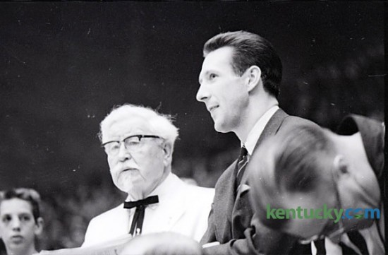 Col. Harland Sanders, founder of Kentucky Fried Chicken, and Adrian Smith, a member of UK's Fiddlin Five that won the 1958 national championship, attend the Kentucky-Vanderbilt basketball game, Jan. 15, 1966 at Memorial Colesium in Lexington. Herald-Leader archive photo.