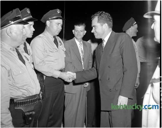 Vice President Richard Nixon, right, shakes hands with Fayette County Patrolman Ted Hughes on Oct. 8, 1954. Also pictured from left are Patrol Lieutenant James Bivens, Patrolman George Mulberry and Assistant Chief Leo Kelly. At the time of this photo, Nixon was less than a year into serving as Dwight D. Eisenhower's vice president. He later became the 37th president of the United States. Herald-Leader archive photo