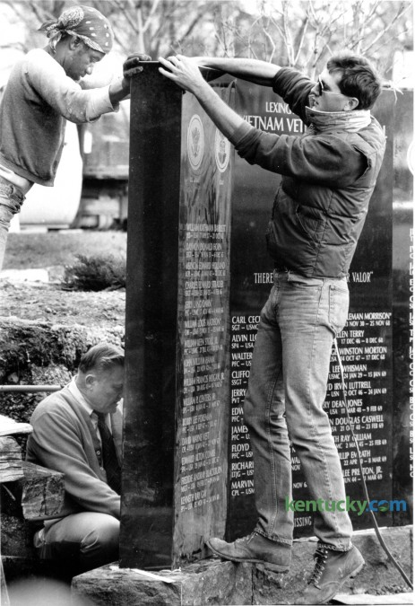 Workers placed Fayette County's Vietnam Veteran's Memorial in Central Park in 1987. Walter Christian, top left, M.E. Wilkerson, lower left and Eddie Wilkerson of Kentucky Monument Service aligned one of the three black granite sections of the Vietnam Veteran's monument on January 6, 1986. The monument weighs about 9000 pounds and contains the names of Fayette County's 50 dead or missing in action veterans. The memorial was formerly dedicated on January 10, 1987. Photo by David Perry | Staff