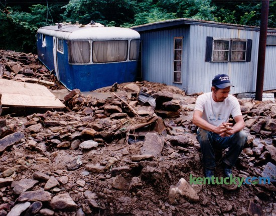 Billy Ray Hubbard sat in silence July 25, 1992 on tons of rubble that had washed down around his mobile home during a flash flood on Bear Creek in Clay County. The small blue and white trailer, where his son and daughter-in-law lived, was swept 50 feet in the flood and came to rest against his home. Photo by Tom Marks | Staff