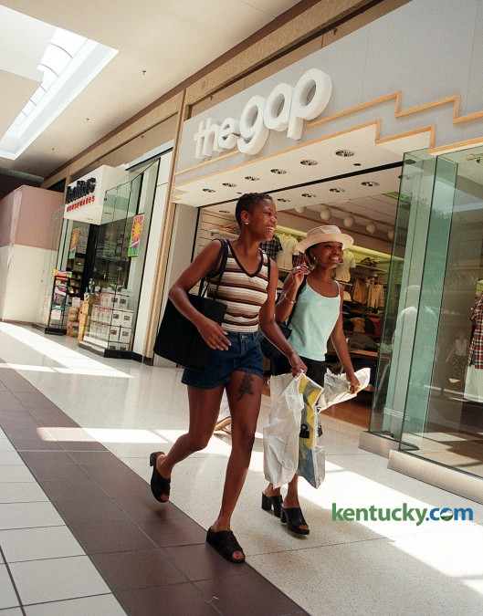 Karla Morton, left, and Gerri Wray, both 22 year old University of Louisville students, shopped at the Gap, May 13, 1998 inside Fayette Mall. The Gap is still at the mall, but the store to the left, Lechters Housewares went out of business in 2001. Photo by Charles Bertram | staff