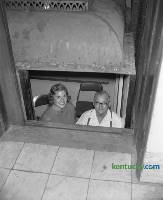 Miss Bobbie Harris and Edgar Hunter, elevator operator at the Courthouse, shown on elevator in which they were stuck for 50 minutes in July of 1958. Published in the Lexington Herald July 22, 1958. Herald-Leader Archive Photo