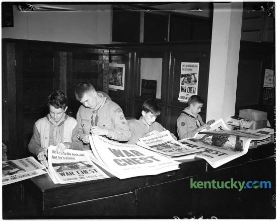 Members of Boy Scout Troop 21 count posters advertising the War Chest Drive during WWII, Oct. 9, 1944. The posters were delivered to downtown business firms.  Pictured from left to right are Fant Martin, Marion Tabb, Billy Hinkle, and George Bolner.  Boy Scouts helping with War Chest drive, October 9, 1944.  The Boy Scouts are counting posters which advertise the War Chest Drive.  The posters were delivered to downtown business firms.  Pictured from left to right are Fant Martin, Marion Tabb, Billy Hinkle, and George Bolner.  They are members of Troop 21. Published in the Lexington Herald October 10, 1944. Herald-Leader Archive Photo