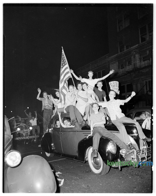 """A group of teenagers pilled on a car in downtown Lexington, Aug. 15, 1945 during Victory over Japan Day, or V-J Day as it was commonly known . V-J Day marked the end of WWII, and the cessation of fighting against Japan. It is also called """"Victory In Japan Day or """"Victory Over Japan Day"""". Herald-Leader Archive Photo"""