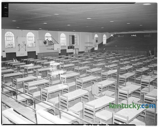 The University of Kentucky gymnasium was converted into temporary sleeping barracks to accommodate 400 of the 2,500 students arriving for opening of Freshman Week in Sept. 1946.