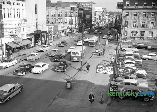 Two-way traffic on East Main Street in downtown Lexington looking towards the east in May of 1956. The building in the upper right corner is the Lafayette Hotel. It closed in 1963 and is now the offices of the Lexington Fayette County Urban County Government. Walnut Street, now called Martin Luther King Boulevard, runs next to the Lafayette Hotel. The parking lot on the left side is now the Fayette County Clerk's Office. The site of the Chase Bank Building located today in Lexington, is in the area of the picture where you see the Bradley's Drugs, Sears and Standard Furniture signage. Herald-Leader Staff Photo