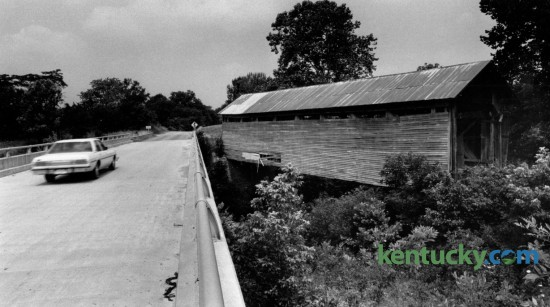 Kentucky highway 158 runs beside Ringo's Mill covered bridge in Fleming County south of Hillsboro.  The 90-foot-long single span Burr truss bridge was built in 1867 and served as a link to Ringo's Mill, a grist mill operated during the 1800's. Photographed June 30, 1981. Photo by Charles Bertram | Staff