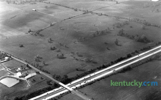 Aerial picture of Hamburg Place horse farm in eastern Fayette County, Oct. 17, 1986. During the 1990s, part of the farm would be developed to be come Hamburg Pavilion, one of the state's largest shopping centers. In the photo, I-75 runs from left to right across the bottom. Intersecting with it is Bryant Road, which would later become part of the Man o' War Boulevard extension that took place in 1988. Today, Target, Old Navy and Dick's Sporting Goods are some of the retail stores that line I-75 on the west side. On the east is Costco and Cabela's, whcih is currently under constrction. About half of the 2,000 acre Hamburg Place farm has now been developed. Photo by Charles Bertram | staff