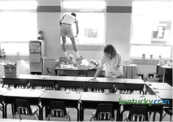 First grade teacher Paige Thornton, right, prepared desks for the first day of school at Squires Elementary School on August 20, 1988. Anthony King of King & Queen's Cleaning Service worked on the classroom's windows. Photo by Tom Woods II | Staff