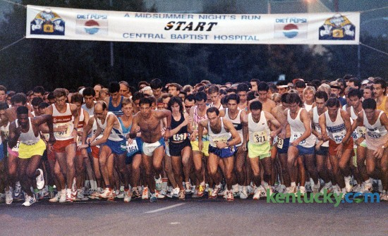 The start of A Midsummer Night's Run, Aug. 18, 1990 in downtown Lexington. The 5K sponsored by Baptist Health Lexington has been an annual summer event since it's first race in 1985 that featured 1,300 participants. The 2015 race on Saturday, Aug. 8 is expected to almost triple that. Photo by Tim Sharp | staff