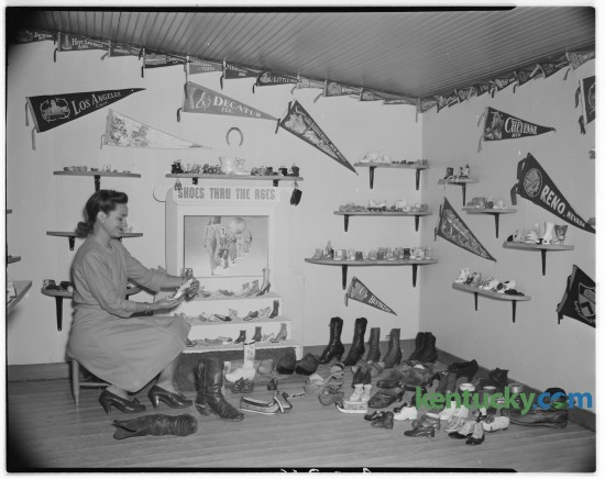 """Gertrude Burke of Lexington was pictured with her shoe collection in September 1946. Burke, who lived on Sandersville Pike,  kept her collection in a special """"shoe house"""" at the rear of her home in which was housed her collection of 445 pairs of shoes. Published in the Lexington Herald September 26, 1946. Herald-Leader Archive Photo"""