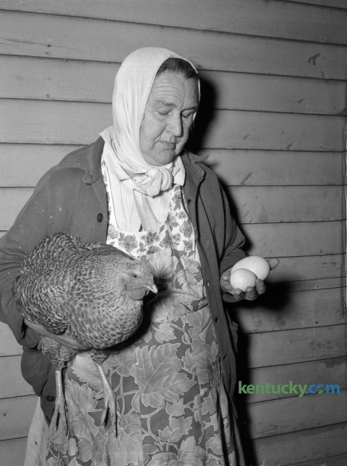 Margaret Mink held a pullet which laid a double-shelled egg weighing more than half a pound. Published in the Lexington Herald March 2, 1948. Herald-Leader Archive Photo