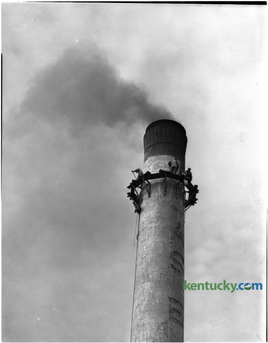 Men at work near the top of the 130-foot smokestack at the Old Pepper Distillery for a painting and patching job. Published in the Lexington Herald-Leader January 14, 1951. Herald-Leader Archive Photo