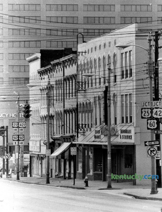 These buildings facing North Broadway between Main Street and Short Street, seen in January 1978, would become part of the block that made up Victorian Square, a commercial district that is on the National Register of Historic Places. Tenants on this bloc in 1978 included PinkstonÕs Hardware and Service, at right. Next was PinsktonÕs Turf & Leather Goods and then, CoxÕs Hotel. The building on the corner of West Main was part of H.H. Leet Furniture Company. It became the home of DeSha's Restaurant and now houses Urban Outfitters. Herald-Leader Archive Photo