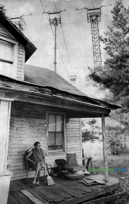 Mildred Edmonds, a resident of Little Georgetown, sat on her front porch beneath approach light towers of then Blue Grass Field, in August 1978. Her house sat on the south side of Parker's Mill Road across from the end of the main runway.  Little Georgetown originated in the nineteenth century after the Civil War on land that had been part of a farm belonging to George Waltz. The community may be named for him or for freed slave George Washington who subdivided some land he owned there in 1877. It once had a school and about 90 residents, but as the airport expanded many residents left the area and others who were directly in the path of the runway were given money by the airport to relocate. Photo by John C. Wyatt | Staff