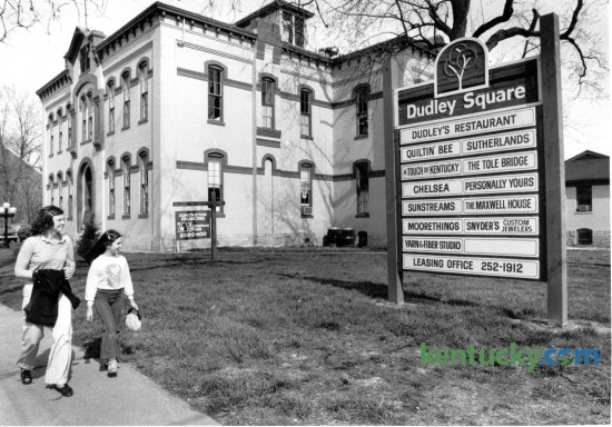 Betty Ann Ring and her cousin Lisa Hall, 9, both of Lexington walked past the old Dudley School building on April 12, 1982. The school building at the corner of East Maxwell and Mill Streets had been converted into a restaurant and shopping destination called Dudley Square. Photo by David Perry | Staff