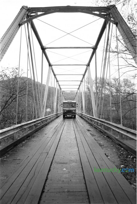A truck crossed the one-lane bridge on Ky 2014 over the Cumberland River near Fourmile in Bell County on November 7, 1985. At that time the state transportation department was preparing to offer it for sale prior to it being replaced. It was built 1873 by the Louisville Bridge and Iron Company and replaced in 1993. Photo by Jim Wakeham | Staff