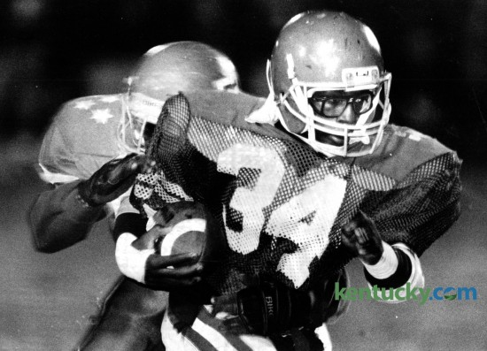 Henry Clay's Tyrone Groves (34) tried to outrun Lafayette's Robert Webb during their inter-city matchup on October 28, 1988. The 5-foot-10, 158-pound junior rushed 19 times for 186 yards. Henry Clay took advantage of six Lafayette turnovers to score a 33-14 season-ending victory and spoil the Generals' high school football homecoming. Photo by Tim Sharp | Staff