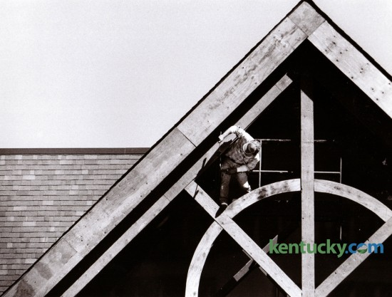 Randall Benge of Nicholasville worked on the gable roof section of a shopping center then known as the Marketplace, on September 24, 1990, at the intersection of Man O' War and Harrodsburg Road, now know as Palomar Center. This is now the opening to Malone's Restaurant.  Photo by Tim Sharp | Staff
