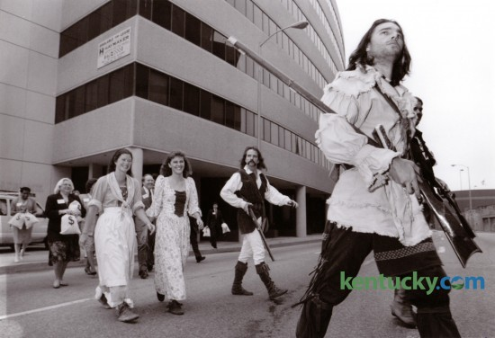 """PNC bank employees were led by """"Daniel Boone"""", actually Tracey Dunn, as they made the symbolic move from their old building, 101 East Vine,  to their new building at 200 West Vine St, August 29, 1994. Photo by Breck Smither"""