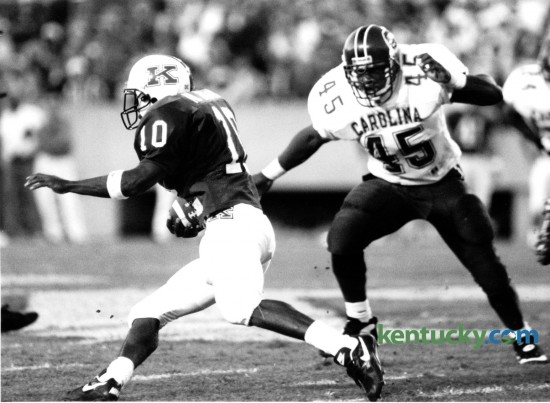 Kentucky running back Moe Williams found some running room against South Carolina during the first half at Commonwealth Stadium on September 24, 1994. UK lost the game 23-9 under fifth year head coach Bill Curry. Kentucky finished the season with one win and 10 losses. Williams left Kentucky after the 1995 season with a career total of 3,333 rushing yards in three seasons (an average of 5.4 yards per carry on 618 attempts), along with 38 receptions for 313 yards (8.2 per catch) and 27 touchdowns. He went on to play in the NFL for 10 years, all but one with the Minnesota Vikings. Photo by Mark Cornelison | Staff