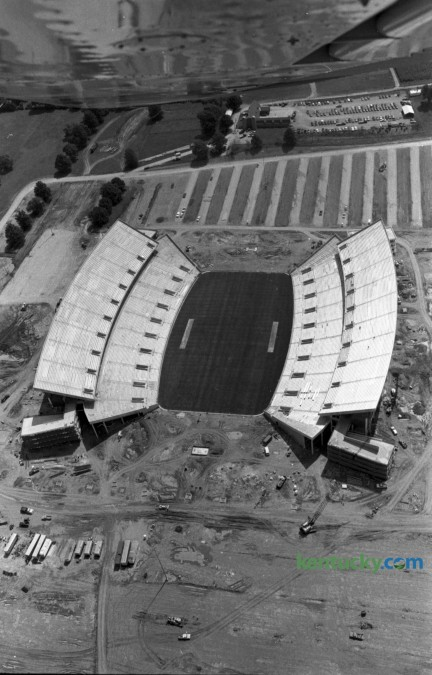 Aerial photo of what would be named Commonwealth Stadium, at the Univeristy of Kentucky, in mid August 1973. When construction was completed in September 1973, Commonwealth Stadium had a capacity of 57,800. It was built  at a cost of $12 million by the firm of Huber, Hunt, and Nichols. The stadium and parking areas rest on an 86-acre plot that was once part of the UK Experimental Station Farm Grounds. The stadium was officially opened on Sept. 15, 1973, as the Wildcats moved into their new home after spending 48 years at Stoll Field/McLean Stadium across from Memorial Coliseum. Kentucky defeated Virginia Tech in the stadium opener, 31-26, as quarterback Ernie Lewis ran for two touchdowns and threw for another TD to lead the Wildcats. Herald-Leader Archive Photo Aerial of CWS, 8/19/73
