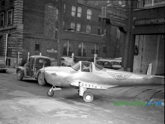 Charles Bohmer, of Bohmer Flying Service, drove his Ercoupe back to Blue Grass Field on February 25, 1947, after a month's display in Kinkead-Wilson Motor Company showrooms, 177 North Mill Street in downtown Lexington. Shorn of it's wings and throttled back to 45 miles and hour the single engine plane navigated city streets and Versailles Pike under its own power without incident. The plane was escorted by city and county patrolmen to the airport. Herald-Leader Archive Photo
