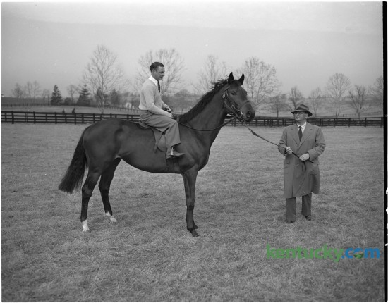 In January 1951 British jockey Harry Carr posed for a photo on Prince Simon who was being held by A.B. Hancock, Jr. At that time Carr was the King's jockey, having been appointed in 1946. He retired from racing in 1964 after having won 1,363 winners. Published in the Lexington Herald January 13, 1951. Herald-Leader Archive Photo