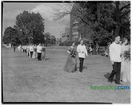 """Members of the Transylvania College's Court of Honor walked across campus on their way to the coronation alter during the Transylvania Day coronation ceremony in May of 1938. Once at the alter, a """"Miss Transylvania"""" and """"Mr. Pioneer,"""" were chosen in the annual event. Transylvania University will install Seamus Carey as its 26th president today at 10am. Unpublished. Herald-Leader Archive Photo"""