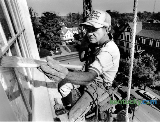 Billy Young, with B.L. Madden and Son, hung from the sixth floor of the Woodlands Condominiums where he was painting windows on October 31, 1984. The Woodlands, at  408 East Main Street, is a nine-story condominium building that was completed in 1984. Photo by Charles Bertram | Staff