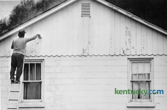 Harold Shepherd applied a fresh coat of paint to a house along Ky. 699 near Leatherwood in Perry County on April 21, 1986. Photo by Jim Wakeham | Staff