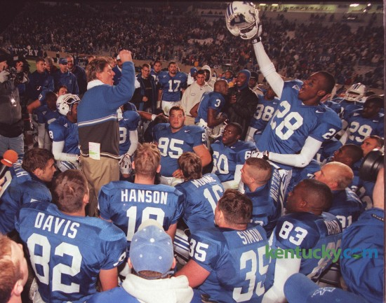 Kentucky coach Hal Mumme, left, and Jermaine White (28) led the team's celebration after defeating Mississippi State 37-35 at Commonwealth Stadium November 7, 1998. In Mumme's second season the Wildcats went 7-5 and lost to Penn State in the Outback Bowl on January 1, 1999. Photo by David Perry | Staff