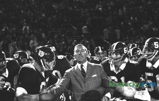 Kentucky football players prepared to put Coach Charlie Bradshaw on their shoulders to carry him off the field after UK defeated Auburn 17-7 at Stoll Field/McLean Stadium in Lexington on October 1, 1966. This was the last time Kentucky defeated Auburn at home. UK did beat Auburn at   Jordan–Hare Stadium in 2009. Herald-Leader Archive Photo