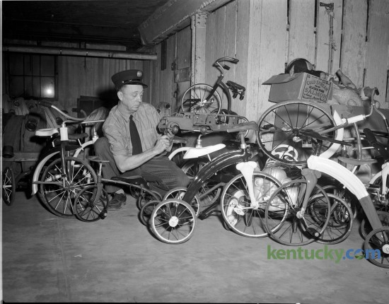 W. T. Kerns, a mechanic with the Lexington Fire Department, with some of the toys he repaired for underprivileged children in December 1948.  Kerns spent many off-duty hours repairing and painting toys for the Blue Grass Council of the Boy Scouts of AmericaToy Drive. Published in the Lexington Leader December 21, 1948. Lexington's Fraternal Order of Firefighters kicks off it's its 84th Annual Toy Drive this Friday. Herald-Leader Archive Photo