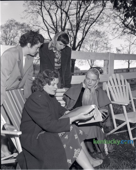 Actress Jean Hagen, seated, left, went over her script before filming the final scene in The Asphalt Jungle, on the Ben Eubank farm on Briar Hill Road in October 1949. Also shown in the photo are Mrs. James Steele, standing, left, Mrs. Ben Eubank Jr., standing, right, and Mrs. Sterling Hayden, seated, right. The Asphalt Jungle is a 1950 film noir directed by John Huston. The cast also featured  Sterling Hayden, Sam Jaffe, Louis Calhern, James Whitmore, and, in a minor but key role, Marilyn Monroe. Published in the Lexington Leader October 14, 1949. Herald-Leader Archive Photo