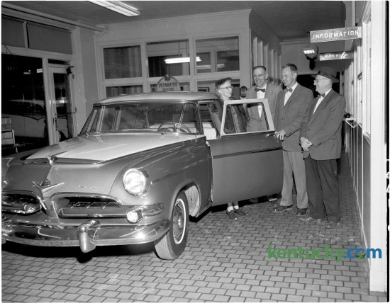 Mr. and Mrs. J. V. Ewan of  Cooper Drive in Lexington bought their 13th Dodge automobile from Goodwin Brothers, Inc., December 21, 1954. Shown with their latest automobile, from left,  are Mrs. Ewan, principal of the Kenwick School; Reid B. Bishop, car salesman; William Goodwin, president of the auto firm and J.V. Ewan. Goodwin Brothers, Inc. sold Plymouth and Dodge automobiles and trucks and was located at 450 E. Main Street. Published in the Lexington Herald December 22, 1954. Herald-Leader Archive Photo