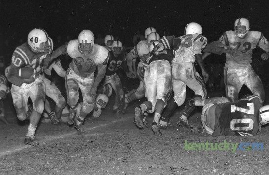 Madison's Freddie Ballou returned a punt for a 75 yard touchdown against the Elizabethtown Panthers in the Recreation Bowl in Mt. Sterling, Ky., October 30, 1961. Madison claimed the Class AA Region 2 championship with a convincing 39-0 blasting of the Elizabethtown Panthers. Herald-Leader Archive Photo