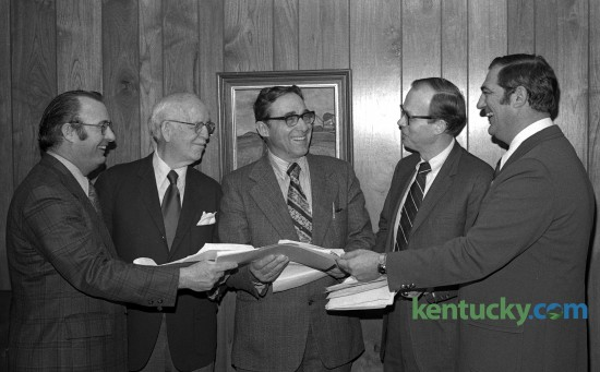 Mayor Foster Pettit, second from right, and the rest of his ticket filed petitions March 28, 1973 to insure thier names being on the ballot for mayor and councilmen-at-large for the urgan county government. From left, City Commissioners Willaim Hoskins and Dr. J. Farra Van Meter, Charles Baesler, county clerk, Mayor Pettit, and County Commissioner Doc Ferrell. In 1971, Pettit was elected as the mayor of Lexington, a non-partisan position which he held from 1972 to 1978. He and Fayette County Judge Robert Stephens oversaw the consolidation of the municipal and county governments in 1974. Herald-Leader Archive Photo ÒFive good menÉ.for a changeÓ   from left, after Dad Ð Bill Hoskins, Richard Vimont, Dr. Farra VanMete, and Scott Yellman. Pettit ticket files petitions for ballot.  L3/28/73