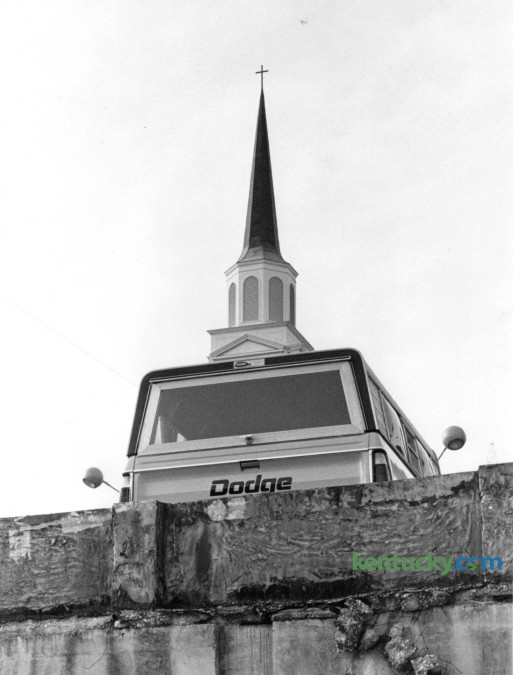 """Former Herald-Leader chief photographer John C. Wyatt spotted the juxtaposition of the truck's camper top and the steeple on Calvary Baptist Church and decided to make what he referred to as a """"corny picture"""". The pickup truck was parked in a lot on High Street and it struck Wyatt as a mobile church when he saw it on February 4, 1976. Photo by John C. Wyatt 