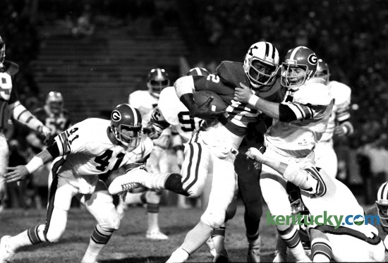 Georgia middle guard Brad Cescutti pulled Kentucky quarterback Derrick Ramsey to a stop afer an eight-yard gain on October 23, 1976. Ramsey was hemmed in by the Bulldogs all evening and ran for only 28 years in 15 carries in the Wildcats' first loss on the season at Commonwealth Stadium, 31-7. Photo by David Perry | Staff