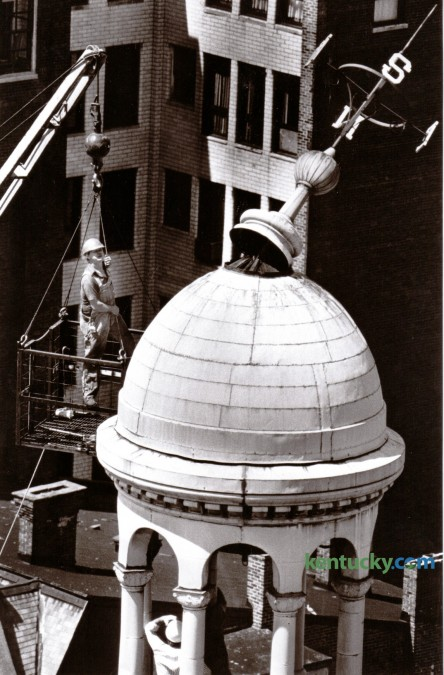 Workers inspected the damaged directional vane on the cupola roof of the Fayette County Courthouse on June 22, 1981. A severe thunderstorm two days earlier caused more than $2 million in damages in and around Lexington due to strong winds. Photo by Ron Garrison | Staff