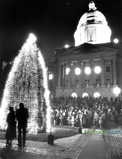 Hundreds of spectators turned out December 11, 1981 in near freezing weather for the lighting of the state Christmas tree on the plaza in front of the Capitol in Frankfort. This year's annual Commonwealth Christmas Tree Lighting was held last night. Photo by David Perry | Staff