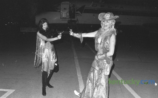 "Exotic dancers Vienna Ithier, left and Patricia Sands offered a not-so-fiery protest against airport ""anti-hijacking"" security measures at Blue Grass Field May 13, 1973. They wore their costumes on the plane from Chicago so the outfits wouldn't be mishandled by airport security. They claimed garments from their on-stage wardrobe were continuallly being ""ripped and torn"" by security police at various airports. The entertainers, in Lexington for a nightclub engagement, were clowning for news photographers after disenbarking. Herald-Leader Archive Photo"