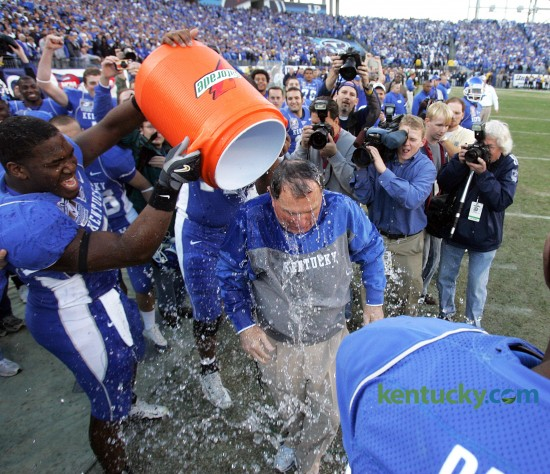 University of Kentucky coach Rich Brooks got a Gatorade bath after the Cats defeated Clemson, 28-20 in the Music City Bowl at LP Field in Nashville, Dec. 29, 2006. A Music City Bowl record 68,024 fans witnessed UK's first bowl victory in 22 years thanks to MVP Andre Woodson's 299 yards passing with three touchdowns. UK would make another trip to the Music City Bowl the following year, beating Florida State 35-28. Photo by Charles Bertram | staff