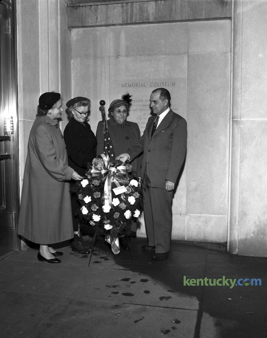 The Lexington chapter of the American War Mothers observed the 10th anniversary of the bombing of Pearl Harbor by placing a wreath in the lobby of Memorial Coliseum in December 1951.  Pictured are (left to right) Mrs. Thurman Hagan, Mrs. L.H. Horlacher, Mrs. J.S. Carpenter, and Bart N. Peak, guest speaker at the ceremony. Published in the Lexington Leader December 7, 1951. Herald-Leader Archive Photo