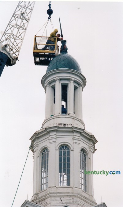 Charles Cunliffe, left and David Roberts, both UK Physical Plant employees worked to repair the lightning rod on top of the steeple on Memorial Hall on September 18, 1992. The tower was struck by lightning during an early morning storm. Firefighters returning from a false alarm on the UK campus about 3:30 a.m. smelled smoke as they neared their Scott Street station. They looked around and spotted a red glow coming from the copper-covered steeple atop Memorial Hall across the street. Lightning had apparently struck the landmark building, bent the lightning rod and set the tower on fire.  Firefighters climbed to the top of the steeple and spread tarps so water from their hoses would trickle off the roof and not damage the building's interior. The fire was quickly extinquished. Photo by Charles Bertram | Staff