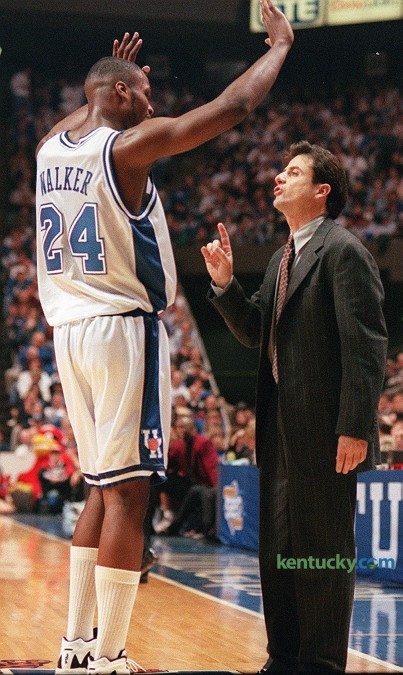 Wildcat coach Rick Pitino talks with forward Antoine Walker during No. 4 Kentucky's 89-66 win over No. 25 Louisville, Dec. 23, 1995 at Rupp Arena in Lexington. Walker had 20 points and 12 rebounds, and guard Tony Delk had 30 points guiding the Cats' to their seventh win on the season. UK would finish the year 34-2 and the programs sixth national title. Photo by Frank Anderson | staff