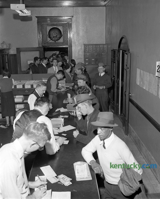 The line for automobile stickers stretched out the second-floor door of the Fayette County clerk's office and spilled into the first-floor lobby of the Fayette County courthouse Feb. 29, 1952. The following day, March 1, was the first day drivers had to have a 1952 license sticker in their windshield signifying their 1951 plate was good in 1952. Kentucky was one of 21 states that used the stickers rather than make new plates to conserve metal. If you were found after March 1 driving without the sticker, the fine ranged from $10-100. Herald-Leader archive photo