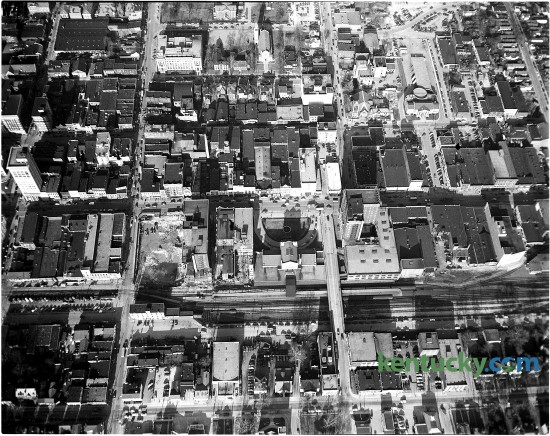 Aerial view of downtown Lexington in August of 1956. The photo's purpose was to show the C&O Railroad tracks in downtown which the city was trying to have removed. The tracks run horizontally just below the middle of the photo. Vine St. is now located where the tracks are in the photo. The old Union Station, with the semi-circular drive, is near the center of the photo. Published in the Lexington Leader August 1, 1956. Herald-Leader Archive Photo