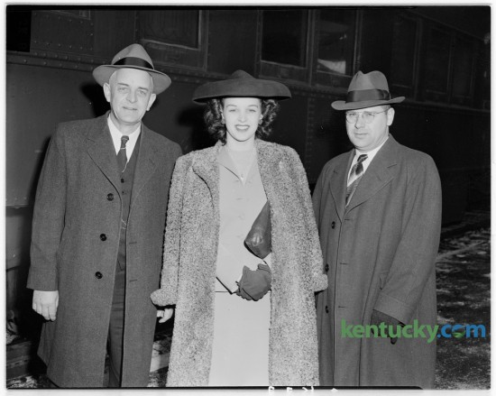 "Miss Venus Ramey, native Kentuckian and Miss America for 1944, pictured during brief stop in Lexington.  Left, Miss Ramey's father, J.C. Ramey, of Waynesburg.  Right, Miss Ramey's brother, J.W. Ramey. Ramey was born September 26, 1924 in Ashland, Ky. She left the state to work for the war effort in Washington, DC, and won the Miss District of Columbia pageant and then became Miss America in 1944. She was the first red-haired contestant to win the title. In 2007, on her farm in Lincoln County, the then 82-year-old used a .38-caliber handgun to shoot out the tires of a car belonging to an intrucer, while balancing on her walker. She held the man until police arrived. She later appeared on The Tonight Show with Jay Leno, who aked her where she learned to shoot. ""I'm from Kentucky,"" she replied. Published in the Lexington Herald December 1, 1944. Herald-Leader Archive Photo"